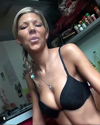 fitness doll whith high heels and pierced belly smoking