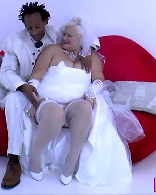 Busty old woman gobbles and rides