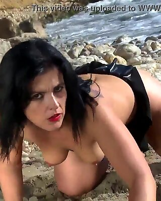 Mature Montse Swinger dancing and stripping on the beach
