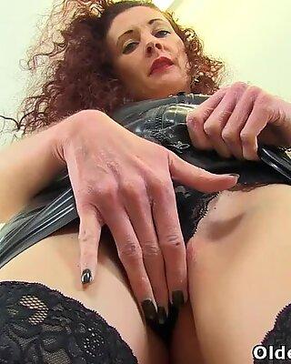 British milf Scarlet fingers her wet cunt