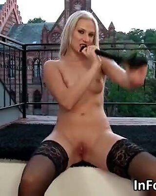 Masturbating blonde babe in sexy black
