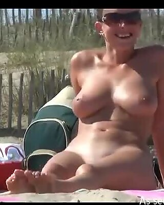 Mature wife exposes her boobs on nude beach