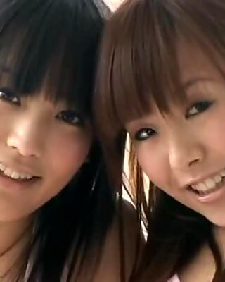 Asian cutie Yuri Hamada and her teen girlfriend in bikinis