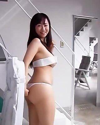 Bootylicious Asian girlie Hitomi Kitamura demonstrates her big boobs